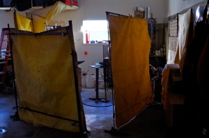 home made frames for the welding curtains. scraps and pieces welded together still standing!!